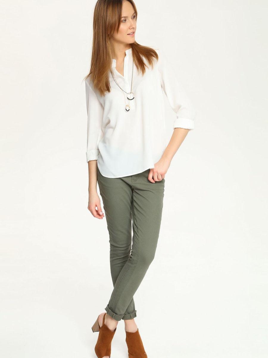 Блузка женская Top Secret, цвет: молочный. SBD0579BI. Размер 34 (40)SBD0579BIЭлегантная женская блуза Top Secret, выполненная из 100% полиэстера, подчеркнет ваш уникальный стиль и поможет создать запоминающийся женственный образ.Блузка с длинными рукавами и V-образным вырезом горловины застегивается на груди на пуговицы, скрытые вертикальной планкой. Манжеты рукавов также застегиваются на пуговицы. Спинка изделия немного удлинена и закруглена. Модель идеально подойдет для жарких летних дней. Такая блузка будет дарить вам комфорт в течение всего дня и послужит замечательным дополнением к вашему гардеробу.