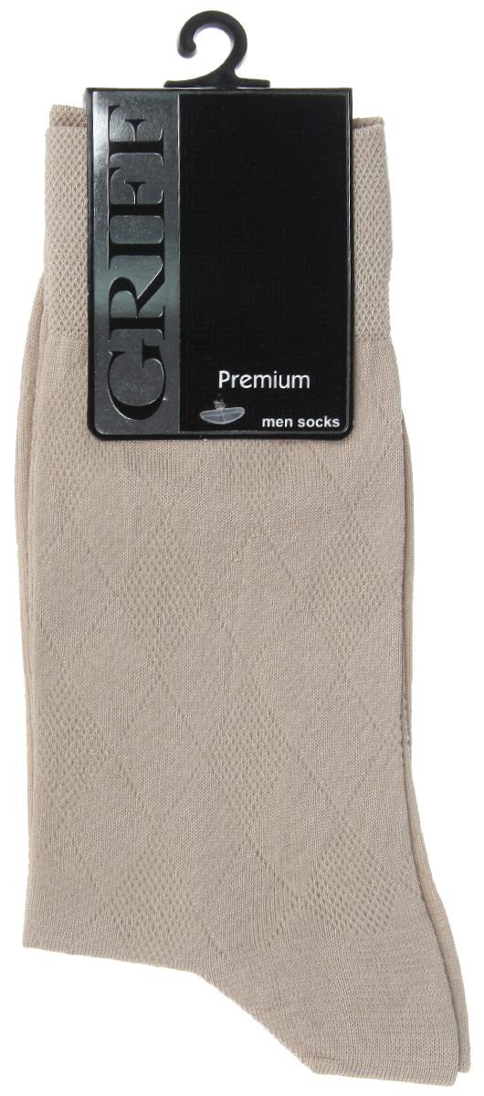 Носки мужские Griff Premium, цвет: бежевый. E5. Размер 42/44E5Мужские носки Griff Premium изготовлены из мерсеризованого хлопка с добавлением полиамидных волокон, которые обеспечивают великолепную посадку. Носки с орнаментом отличаются элегантным внешним видом. Удобная широкая резинка идеально облегает ногу и не пережимает сосуды, усиленные пятка и мысок повышают износоустойчивость носка, а удлиненный паголенок придает более эстетичный вид.