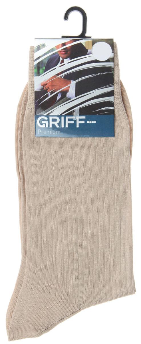 Носки мужские Griff Premium, цвет: бежевый. E4. Размер 45/47E4Мужские носки Griff Premium изготовлены из высококачественного сырья с добавлением полиамидных волокон, которые обеспечивают великолепную посадку. Носки отличаются элегантным внешним видом. Удобная широкая резинка идеально облегает ногу и не пережимает сосуды, усиленные пятка и мысок повышают износоустойчивость носка, а удлиненный паголенок придает более эстетичный вид.