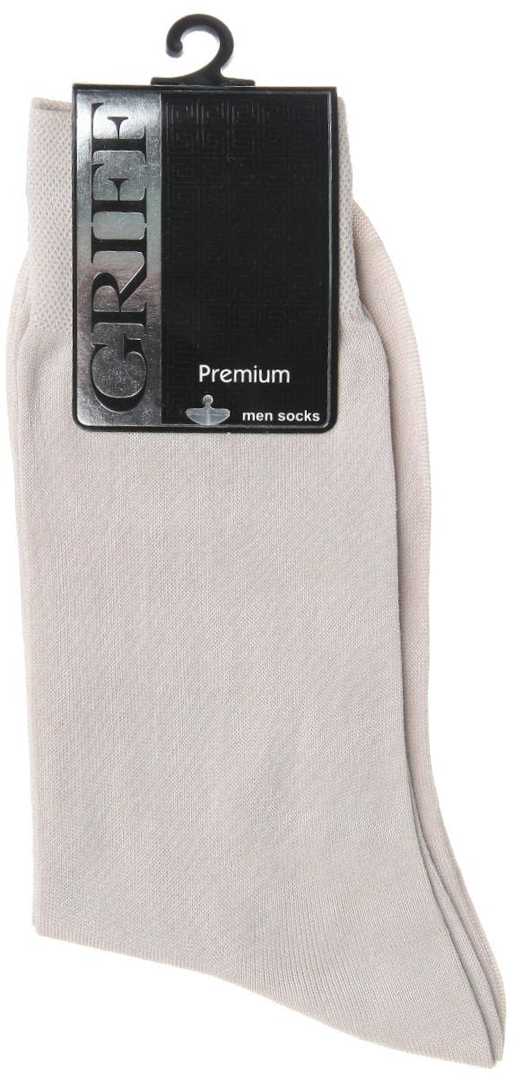 Носки мужские Griff Premium, цвет: светло-серый. E1. Размер 39/41E1Мужские носки Griff Premium изготовлены из высококачественного сырья с добавлением полиамидных волокон, которые обеспечивают великолепную посадку. Носки отличаются элегантным внешним видом. Удобная широкая резинка идеально облегает ногу и не пережимает сосуды, усиленные пятка и мысок повышают износоустойчивость носка, а удлиненный паголенок придает более эстетичный вид.