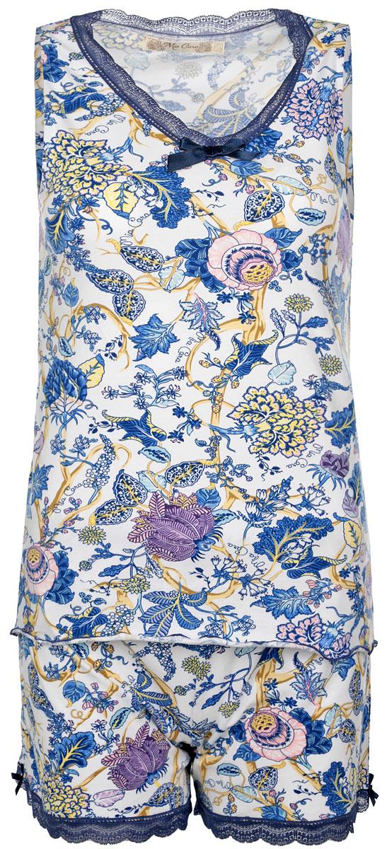 Пижама женская Mia Cara: майка, шорты, цвет: белый, синий, розовый. AW15-UAT-LST-657. Размер 46/48AW15-UAT-LST-657Женская пижама Mia Cara, состоящая из майки и шорт, идеально подойдет для отдыха и сна. Модель выполнена из высококачественного хлопка, очень мягкая на ощупь, не сковывает движения, хорошо пропускает воздух. В ткань вплетены специальные волокна эластана, которые позволяют создать прилегающий силуэт и обеспечить комфорт. Изделие обладает благородными и стойкими цветами, устойчивыми к воздействиям в процессе использования и стирки. Майка с V-образным вырезом горловины оформлена цветочным принтом. Вырез горловины дополнен кружевом.Шорты на талии имеют мягкую эластичную резинку. Низ брючин дополнен кружевом и небольшими атласными бантиками. Модная пижама позволит вам всегда выглядеть эффектно и элегантно, а также подчеркнет вашу красоту!