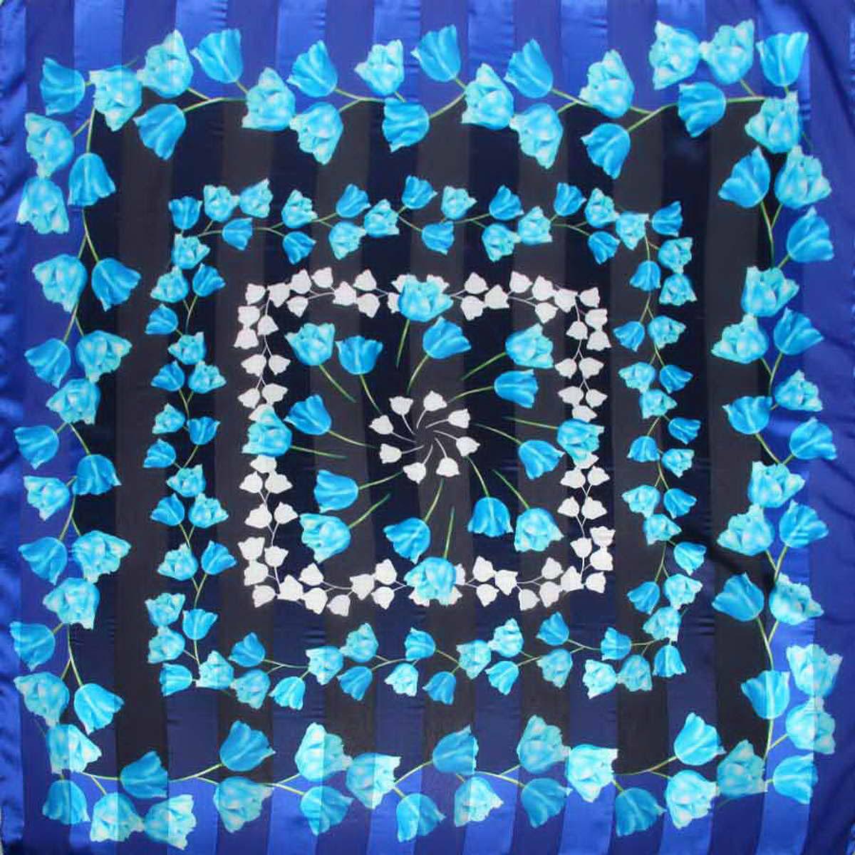 Платок женский Venera, цвет: голубой, синий, темно-синий. 3904972-17. Размер 90 см х 90 см3904972-17Стильный женский платок Venera станет великолепным завершением любого наряда. Платок изготовлен из полиэстера и оформлен цветочным принтом. Классическая квадратная форма позволяет носить платок на шее, украшать им прическу или декорировать сумочку. Легкий и приятный на ощупь платок поможет вам создать изысканный женственный образ. Такой платок превосходно дополнит любой наряд и подчеркнет ваш неповторимый вкус и элегантность.