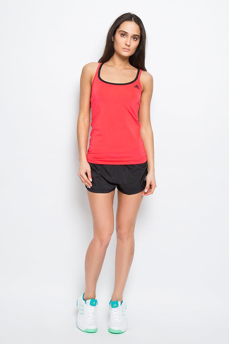 Майка для бега женская Adidas Basic Strappy, цвет: коралловый, черный. AJ5377. Размер XXS (38)AJ5377Женская майка Adidas Basic Strappy, выполненная из эластичного полиэстера, прекрасно подходит для занятий спортом как в тренажерном зале, так и на беговой дорожке. Майка приталенного кроя с глубоким круглым вырезом горловины создана для легкости и свободы движений. Модель отводит влагу от кожи, сохраняя ощущение сухости и комфорта во время тренировки. Тонкие двойные лямки с перекрестным переплетением на спине. Изделие оформлено логотипом бренда.Такая модель будет дарить вам комфорт в течение всего дня и станет отличным дополнением к вашему гардеробу.