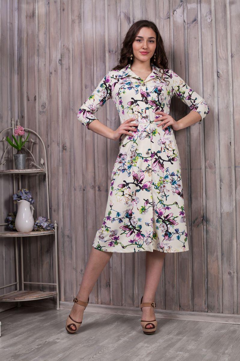 Платье Lautus, цвет: молочный, розовый, зеленый, коричневый. 781. Размер 46781Элегантное платье Lautus выполнено из высококачественного эластичного полиэстера с добавлением вискозы. Оно обеспечит вам комфорт и удобство при носке.Модель с рукавами 3/4 и отложным воротником выгодно подчеркнет все достоинства вашей фигуры, благодаря приталенному силуэту. Изделие оформлено модным цветочным принтом. Платье-миди застегивается на объемные пластиковые пуговицы спереди по всей длине изделия. Рукава дополнены манжетами. Изысканная модель создаст обворожительный и неповторимый образ.Это модное и удобное платье станет превосходным дополнением к вашему гардеробу, оно подарит вам удобство и поможет вам подчеркнуть свой вкус и неповторимый стиль.