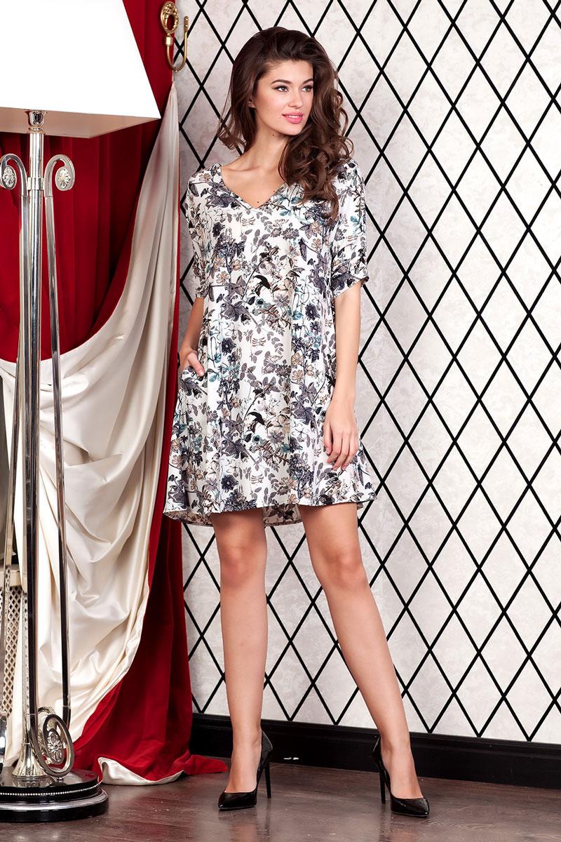 Платье Ruxara, цвет: белый. 111252_01. Размер 48111252_01Стильное мини-платье с карманами в боковых швах из лёгкой ткани с цветочным принтом мгновенно создаст летнее настроение! Модель свободного кроя с V-образным вырезом горловины. Втачной рукав 3/4 со спущенным плечом декорирован складками.