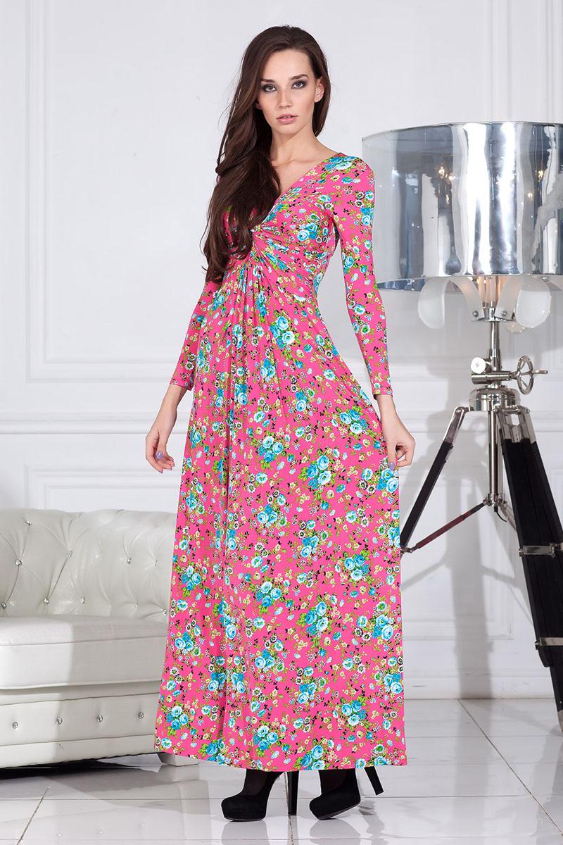 Платье Ruxara, цвет: ярко-розовый. 100301_65. Размер 42100301_65Платье клешеное длиной в пол с длинным рукавом выполнено из высококачественного материала. Впереди драпировка узел.
