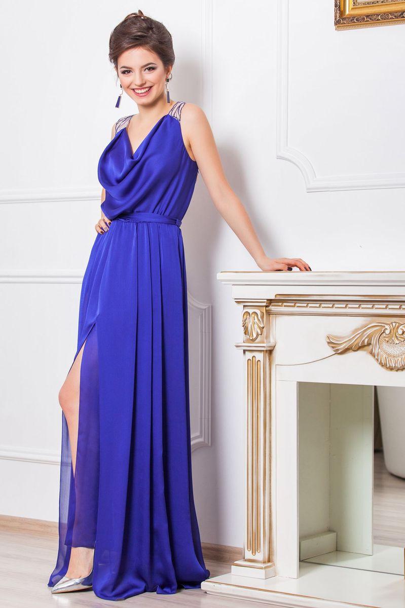 Платье Seam, цвет: индиго, бежевый. 4640_608. Размер M (46)4640_608Очаровательное вечернее платье Seam, выполненное из высококачественного полиэстера, оно отлично сидит по фигуре и подчеркнет ваши достоинства.Платье-макси с воротником-качели не имеет рукавов и застежек.Сзади по спинке модель выполнена легкой тканью с вышивкой лепестков и прорезями. Сбоку платье дополнено большим разрезом и в поясе оформлено шлевками и небольшим пояском.
