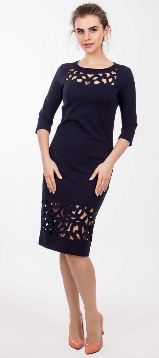 Платье Seam, цвет: темно-синий. 4130_707. Размер M (46)4130_707Очаровательное платье Seam выполнено из полиэстера с добавлением вискозы, оно необычайно мягкое и эластичное, дарит комфорт при носке. Платье-миди с рукавами 3/4 и круглым вырезом горловины не имеет застежек. Область груди и низ изделия оформлены оригинальными прорезными узорами, что делает платье стильным и неповторимым.