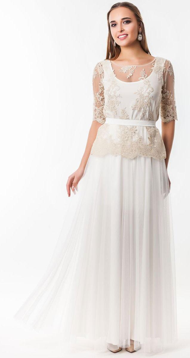 Платье Seam, цвет: ванильный. 4810_201. Размер L (48)4810_201Очаровательное вечернее платье Seam, выполненное из высококачественного полиэстера, оно отлично сидит по фигуре и подчеркнет ваши достоинства.Платье-макси состоит из юбки, удлиненной майки и накладной блузы. В поясе юбка на эластичной резинке, а верх выполнен из пышной сетчатой ткани. Удлиненная майка служит подкладкой в данной модели. Накладная блуза надевается сверху и застегивается по спинке на пуговицы.Оформлена блуза элегантной вышивкой из нитей с люрексом.