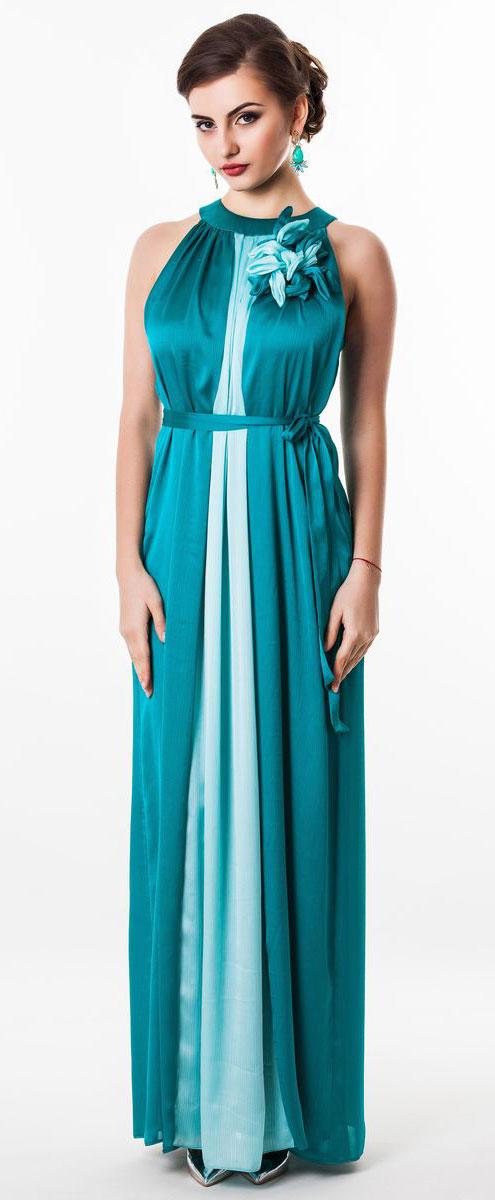 Платье Seam, цвет: темно-бирюзовый. 4620_705. Размер M (46)4620_705Очаровательное вечернее платье Seam, выполненное из высококачественного полиэстера, оно отлично сидит по фигуре и подчеркнет ваши достоинства. Платье-макси без рукавов сзади на шее застегивается на две пуговицы. Модель свободного кроя от начала горловины оформлена элегантными складочками. Платье дополнено контрастным пояском, который закрепляется с помощью заколки-брошки в виде цветка.