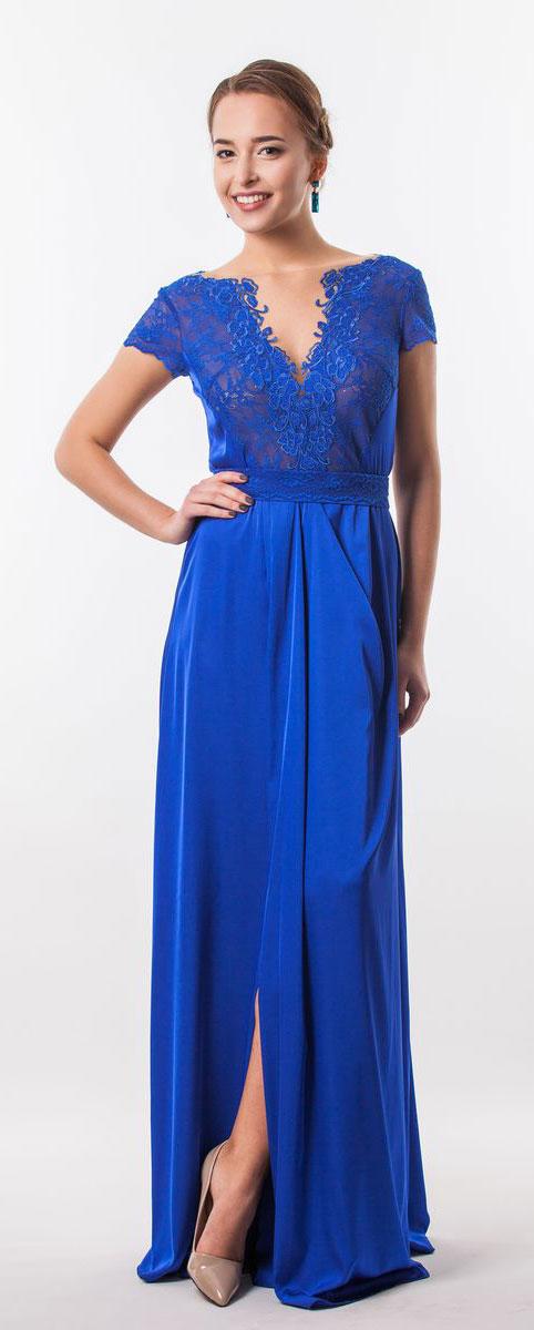 Платье Seam, цвет: темно-синий. 4660_706. Размер M (46)4660_706Стильное платье Seam выполнено из полиэстера с добавлением спандекса. Платье-макси с круглым вырезом горловины и короткими кружевными рукавами. Лиф модели оформлен вставками из сетчатого и кружевного материала и декорирован вышитыми цветами. Двойная юбка модели имеет небольшой запах. По талии платье присобрано на резинку и дополнена мягкими складками. К изделию прилагается текстильный пояс застегивающийся на пуговицу.