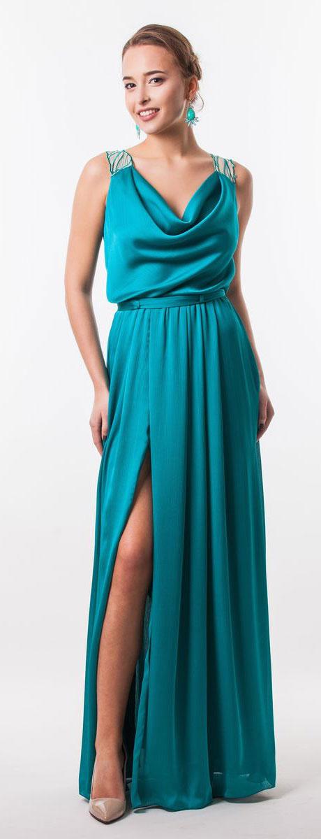 Платье Seam, цвет: бирюзовый, бежевый. 4640_705. Размер L (48)4640_705Очаровательное вечернее платье Seam, выполненное из высококачественного полиэстера, оно отлично сидит по фигуре и подчеркнет ваши достоинства.Платье-макси с воротником-качели не имеет рукавов и застежек.Сзади по спинке модель выполнена легкой тканью с вышивкой лепестков и прорезями. Сбоку платье дополнено большим разрезом и в поясе оформлено шлевками и небольшим пояском.