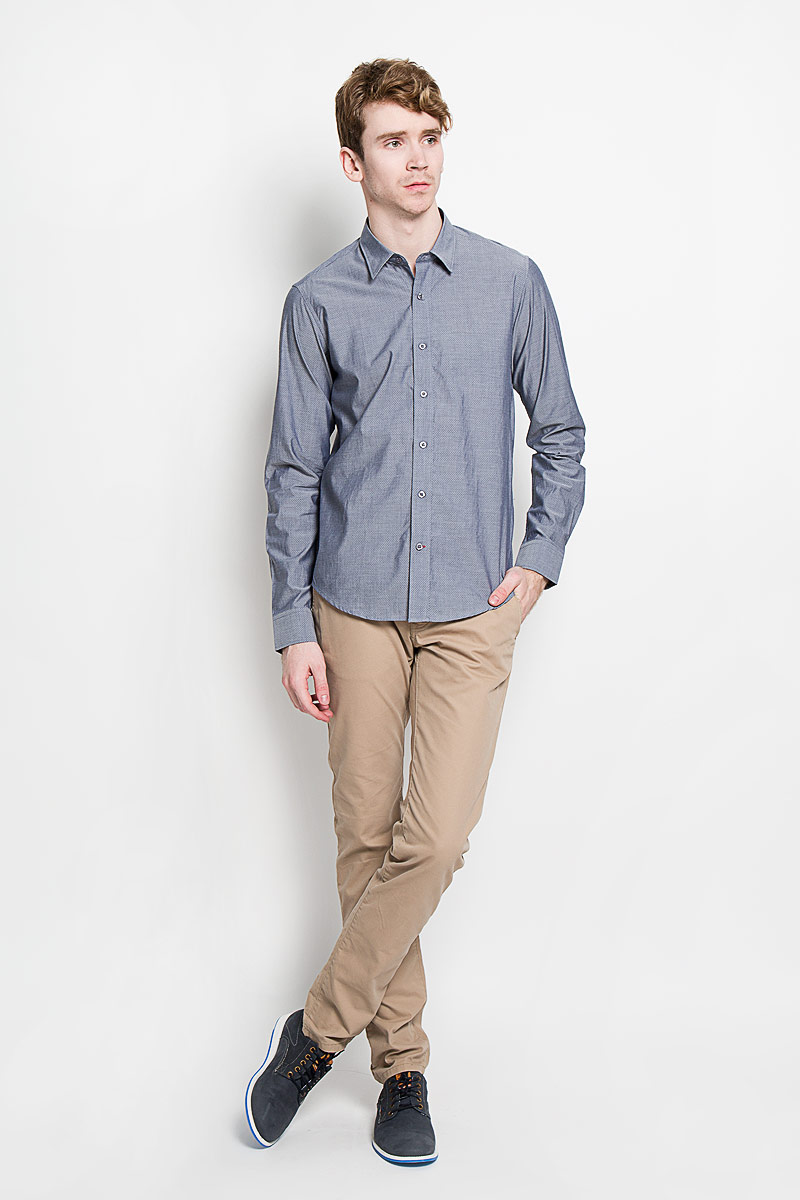 Рубашка мужская KarFlorens, цвет: серый. SW 76-02. Размер 43/44 (54/182)SW 76-02Мужская рубашка KarFlorens в стиле casual, изготовленная из высококачественного 100% хлопка, необычайно мягкая и приятная на ощупь, она не сковывает движения и позволяет коже дышать, обеспечивая комфорт.Модель с отложным воротником, длинными рукавами и полукруглым низом застегивается на пластиковые пуговицы. Изделие оформлено принтом микроточки. Рукава рубашки дополнены манжетами на пуговицах, со шлицами и складками в месте соединения с манжетом. Ширину манжета можно варьировать, благодаря дополнительной пуговице. Пуговицы декорированы логотипом KarFlorens, на правой манжете - вышивка-логотип. Эта рубашка - идеальный вариант для повседневного гардероба. Такая модель порадует настоящих ценителей комфорта и практичности!