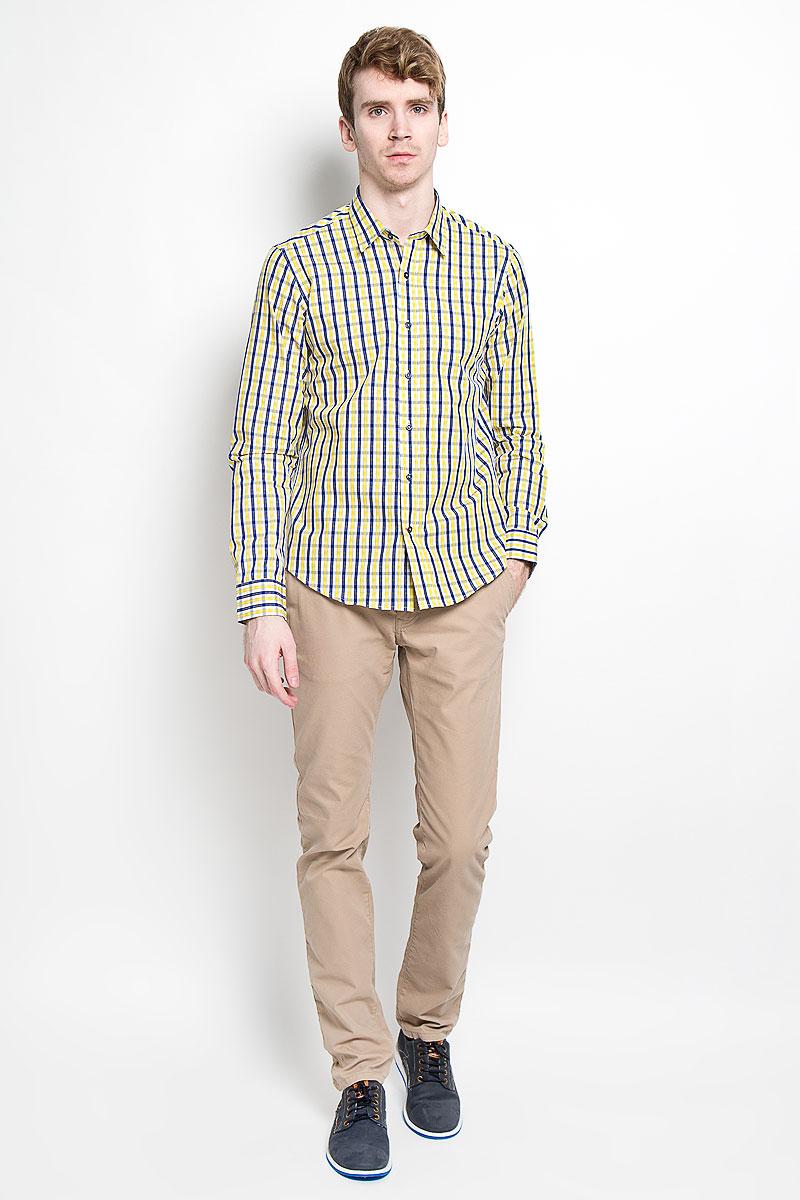 Рубашка мужская KarFlorens, цвет: желтый, синий, белый. SW 76_04. Размер 41/42 (50-52/176)SW 76_04Мужская рубашка KarFlorens, изготовленная из высококачественного 100% хлопка, необычайно мягкая и приятная на ощупь, она не сковывает движения и позволяет коже дышать, обеспечивая комфорт.Модель с длинными рукавами и отложным воротником застегивается на пластиковые пуговицы, которые декорированы названием бренда. Закругленные манжеты с регулировкой ширины также застегиваются на пуговицы. Оформлено изделие принтом в клетку.Такая рубашка станет идеальным вариантом для повседневного гардероба. Она порадует настоящих ценителей комфорта и практичности!