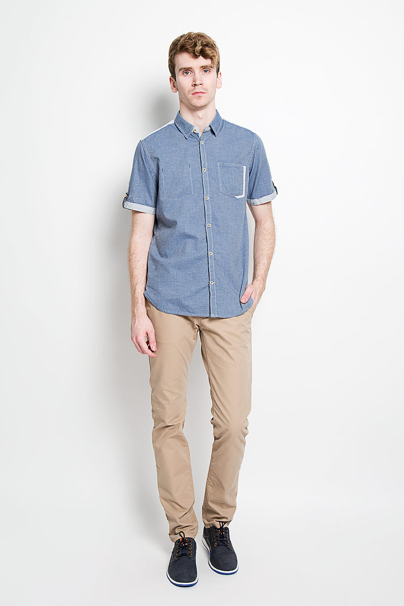 Рубашка мужская Tom Tailor, цвет: джинс. 2031671.00.10_6865. Размер XXL (54)2031671.00.10_6865Стильная мужская рубашка Tom Tailor, изготовленная из высококачественного хлопка, необычайно мягкая и приятная на ощупь, не сковывает движения и позволяет коже дышать, обеспечивая наибольший комфорт.Модная рубашка с отложным воротником, короткими рукавами и полукруглым низом застегивается на пластиковые пуговицы по всей длине изделия. Рубашка оформлена нашивным карманом слева на груди, а справа - декоративной отстрочкой. Рукава дополнены декоративными хлястиками на пуговицах. Верхняя часть спинки и края рукавов выполнены в более светлом цвете. На спинке расположена фирменная нашивка. Эта рубашка идеально подойдет для повседневного гардероба.Такая модель порадует настоящих ценителей комфорта и практичности!