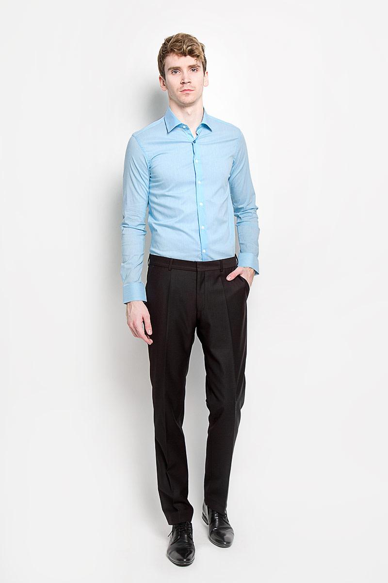 Рубашка мужская KarFlorens, цвет: голубой. SW 84_04. Размер 41/42 (50-52/176)SW 84_04Мужская рубашка KarFlorens, изготовленная из высококачественного хлопка с добавлением нейлона и лайкры, необычайно мягкая и приятная на ощупь, она не сковывает движения и позволяет коже дышать, обеспечивая комфорт.Рубашка с длинными рукавами и отложным воротником застегивается на пуговицы, которые оформлены тиснением с названием бренда. Манжеты со срезанными уголками и регулировкой ширины также застегиваются на пуговицы.Такая рубашка станет идеальным вариантом для повседневного гардероба. Она порадует настоящих ценителей комфорта и практичности!