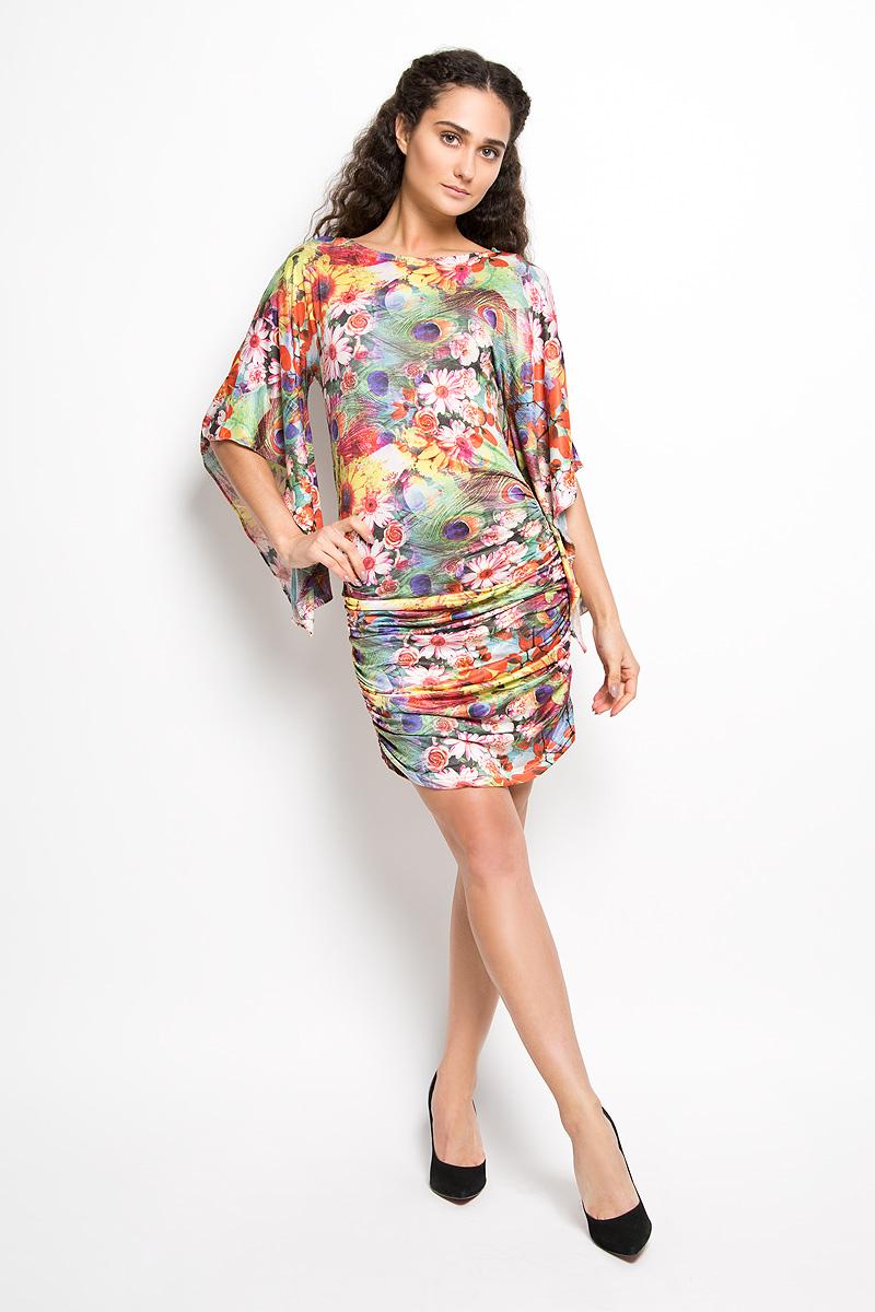 Платье Karff, цвет: зеленый, желтый, мультиколор. LD 017-04. Размер L (48)LD 017-04Прелестное трикотажное платье Karff подчеркнет ваш уникальный стиль и поможет создать оригинальный женственный образ. Модель прилегающего покроя с фигурными цельнокроеными рукавами 3/4 и круглым вырезом горловины покорит вас с первого взгляда. По бокам платье дополнено вертикальной сборкой, за счет которой платье красиво драпируется. Платье оформлено ярким цветочным принтом.Такое платье станет стильным дополнением к вашему гардеробу.