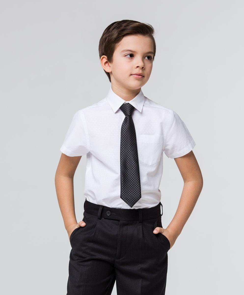 Рубашка для мальчика Silver Spoon, цвет: белый. SSFSB-629-13930-214. Размер 164SSFSB-629-13930-214Стильная рубашка Silver Spoon станет отличным дополнением к школьному гардеробу вашего мальчика. Модель, выполненная из хлопка с добавлением полиэстера, необычайно мягкая и приятная на ощупь, не сковывает движения и позволяет коже дышать. Рубашка классического кроя с короткими рукавами и отложным воротником застегивается на пуговицы по всей длине. Модель оформлена оригинальным принтом в тон рубашки. На груди расположен накладной карман.