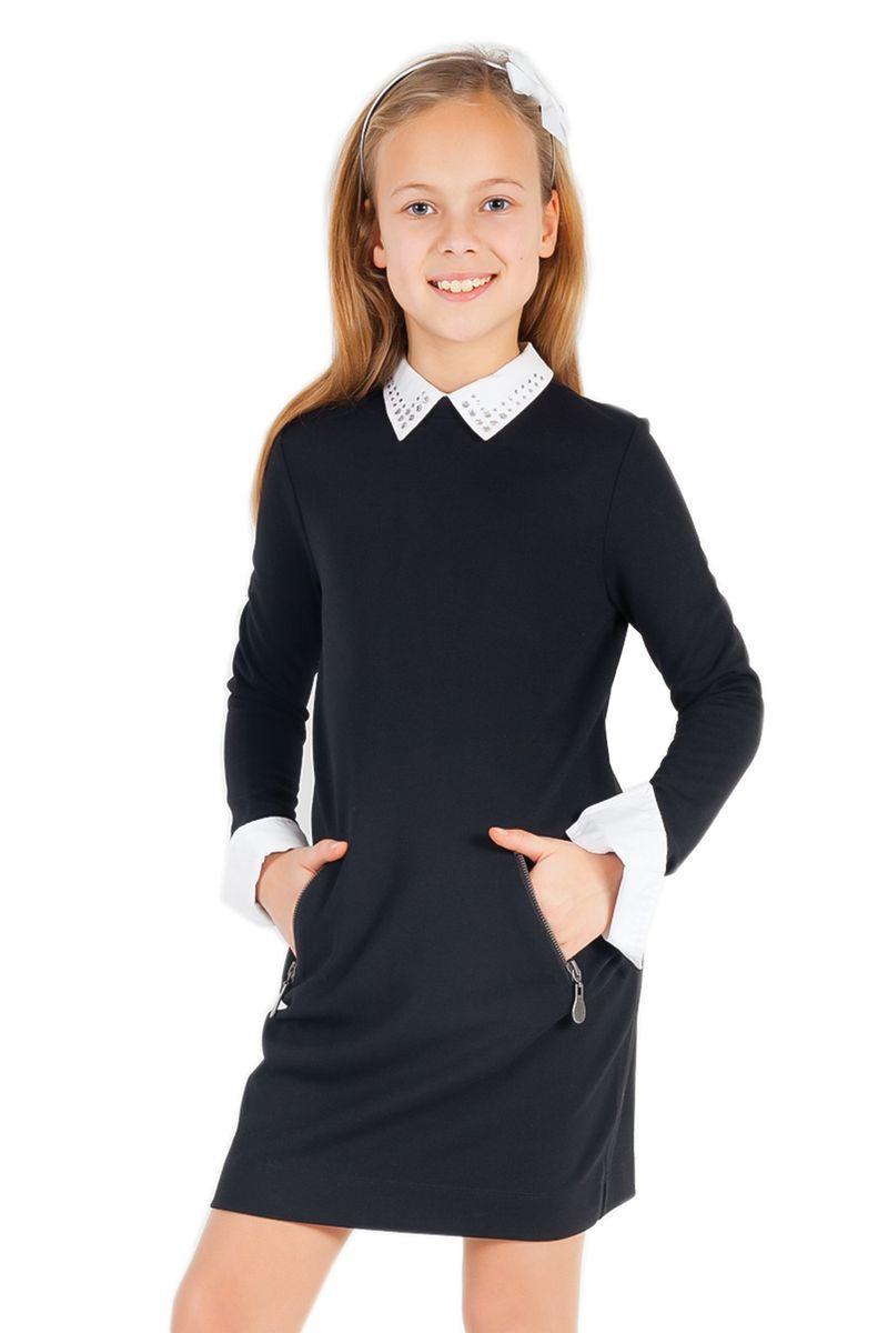 Платье для девочки Gulliver, цвет: темно-синий. 21502GSC5005. Размер 158, 12-13 лет21502GSC5005Очаровательное платье для девочки Gulliver идеально подойдет вашей малышке. Платье выполнено из эластичной вискозы с добавлением нейлона, оно необычайно мягкое, не сковывает движения малышки, великолепно отводит влагу от тела и не раздражает даже самую нежную и чувствительную кожу ребенка, обеспечивая наибольший комфорт. Платье-миди с длинными рукавами и отложным воротником застегивается на застежку-молнию и пуговицу на спинке. Спереди расположены два втачных кармана на застежках-молниях. Рукава дополнены контрастными манжетами на пуговицах. Украшенный стразами воротник пришит ручными стежками и при необходимости легко отпарывается и заменяется. Оригинальный современный дизайн и модная расцветка делают это платье практичным и стильным предметом школьного гардероба. В нем ваша малышка будет чувствовать себя уютно и комфортно и всегда будет в центре внимания!