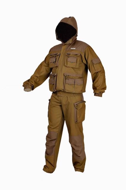 Костюм мужской Тоджа-флис, цвет: коричневый. 0055812. Размер 56/58-182/188Тоджа-флис (0055)Костюм Тоджа флис - летний мужской костюм, состоящий из куртки и полукомбинезона. Комплект изготавливается: верх из ткани Таслан и палаточного полотна (100% хлопок), подкладка: из бязи (подкладка капюшона и подкладка полукомбинезона), флиса (подкладка полочек и спинки) и подкладочной ткани (подкладка рукавов). Ткань Таслан обладает водоотталкивающими свойствами и защищает от промокания в непогоду.Куртка с притачной подкладкой, укороченная. Центральная застежка на молнию и с фигурным пластроном, фиксируемым на ленту велькро. По низу куртки пояс с эластичной лентой. Полочки куртки оснащены карманами портфель с застежкой на молнию, верхняя и передняя планка из отделочной ткани: два нагрудных и два нижних. На нагрудных карманах разгрузочный карман с клапаном из отделочной ткани (на клапанах пата из ленты) с застежкой на велькро. Нижние карманы- портфели имеют по два разгрузочных кармана с клапанами из отделочной ткани (на клапанах пата из ленты) с застежкой на велькро. Вдоль нижнего кармана портфель в сторону бокового шва куртки обработаны прорезные карманы с листочкой из отделочной ткани на молнию. На левом подборте подкладки куртки прорезной карман в рамку с молнией.Рукав на манжете. Манжета частично из эластичной ленты. На задней части рукава в области локтя настрочен фигурный налокотник из отделочной ткани. На левом рукаве карман с клапаном из отделочной строчки с застежкой на велькро.Капюшон втачивается в горловину куртки из отделочной ткани. Центральная часть капюшона регулируется пряжкой и хлястиком из тесьмы, а лицевая часть шнуром и фиксатором. Капюшон с подкладкой из бязи.Полукомбинезон с притачной подкладкой (из бязи) и с отстегивающей спинкой на бретелях. Бретели регулируются по длине эластичной лентой и фиксируются с помощью двухщелевых пряжек и передних шлевок с лентой велькро.На передних половинках брюк боковые карманы с отрезным бочком из отделочной ткани и боковые