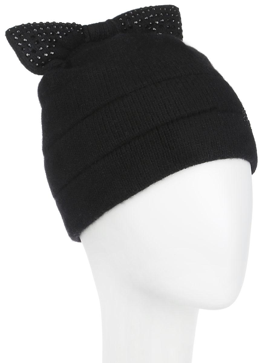 Шапка женская Flioraj, цвет: черный. 398. Размер 56/58398Оригинальная женская шапка Flioraj дополнит ваш наряд и не позволит вам замерзнуть в холодное время года. Шапка выполнена из высококачественной комбинированной пряжи из шерсти и акрила, что позволяет ей великолепно сохранять тепло и обеспечивает высокую эластичность и удобство посадки. Шапка оформлена мелкими стразами и дополнена небольшим вязаным бантом сверху.Такая шапка станет модным и стильным дополнением вашего зимнего гардероба, великолепно подойдет для городских прогулок, а также активного отдыха и занятия спортом. Она согреет вас и позволит подчеркнуть свою индивидуальность! Уважаемые клиенты! Обращаем ваше внимание на тот факт, что размер, доступный для заказа, является обхватом головы.