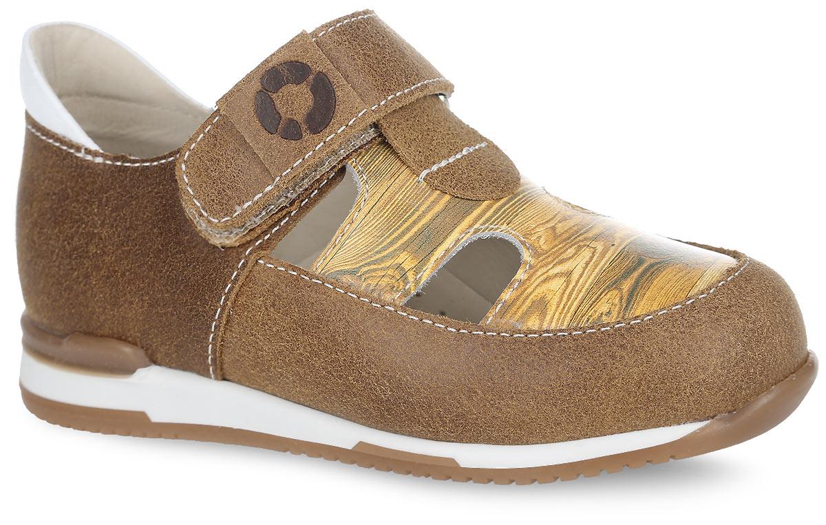 Туфли детские TapiBoo, цвет: бук, коричневый. FT-25003.16-OL36O.01. Размер 25FT-25003.16-OL36O.01Стильные туфли от TapiBoo придутся по душе вашему ребенку. Модель выполнена из натуральной кожи разной фактуры и оформлена в области подъема принтом, стилизованным под дерево, резными отверстиями для лучшего воздухообмена, на ремешке - шильдой с логотипом, по канту - контрастной вставкой из кожи. Подкладка и стелька, изготовленные из натуральной кожи, гарантируют комфорт при ходьбе. Подкладка обладает мягкостью и природной способностью пропускать воздух для создания оптимального температурного режима и предотвращения натирания ножки. Многослойная, анатомическая стелька дополнена сводоподдерживающим элементом для правильного формирования стопы. Ремешок на застежке-липучке позволяет легко снимать и надевать обувь даже самым маленьким детям, обеспечивая при этом оптимальную фиксацию. Жесткий фиксирующий задник надежно стабилизирует голеностопный сустав во время ходьбы, препятствуя развитию патологических изменений стопы. Эластичный подносок надежно защищает переднюю часть стопы ребенка, не сжимая пальцы ног и оставляя достаточно пространства для естественной подвижности передней части стопы. Широкий, устойчивый каблук специальной конфигурации продлен с внутренней стороны, чтобы исключить вращение (заваливание) стопы вовнутрь. Упругая, умеренно-эластичная подошва имеет перекат, позволяющий повторить естественное движение стопы при ходьбе для правильного распределения нагрузки на опорно-двигательный аппарат ребенка. Рифление на подошве для лучшего сцепления с поверхностями. Такие туфли займут достойное место среди коллекции обуви вашего ребенка.