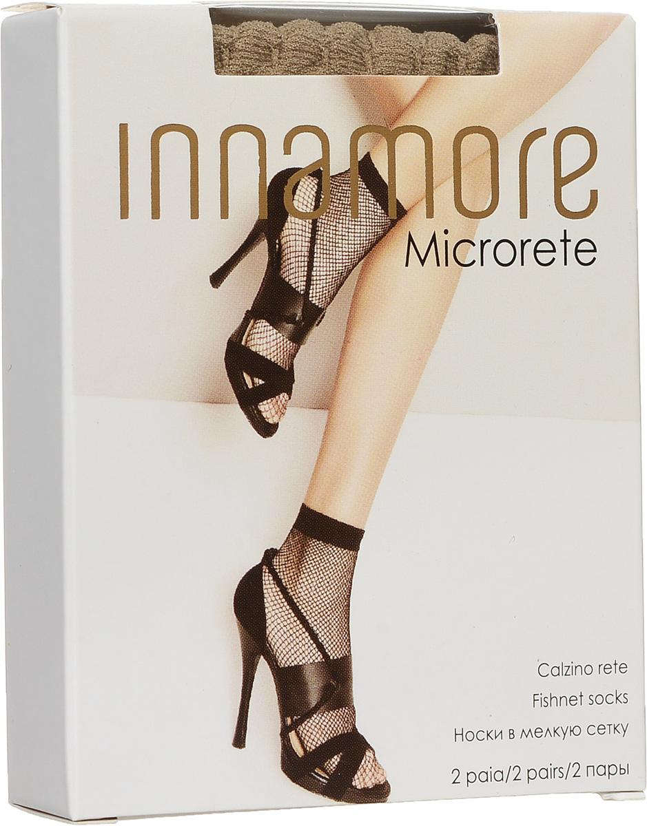 Носки женские Innamore Microrete 20, цвет: Miele (телесный), 2 пары. 7819. Размер универсальный7819Удобные женские носки в мелкую сетку Innamore Microrete 20, изготовленные из высококачественного эластичного полиамида, идеально подойдут для повседневной носки. Входящий в состав материала полиамид обеспечивает износостойкость, а эластан позволяет носочкам легко тянуться, что делает их комфортными в носке.Эластичная резинка плотно облегает ногу, не сдавливая ее, обеспечивая комфорт и удобство и не препятствуя кровообращению. Практичные и комфортные носки великолепно подойдут к любой открытой обуви. В комплект входят 2 пары носков.