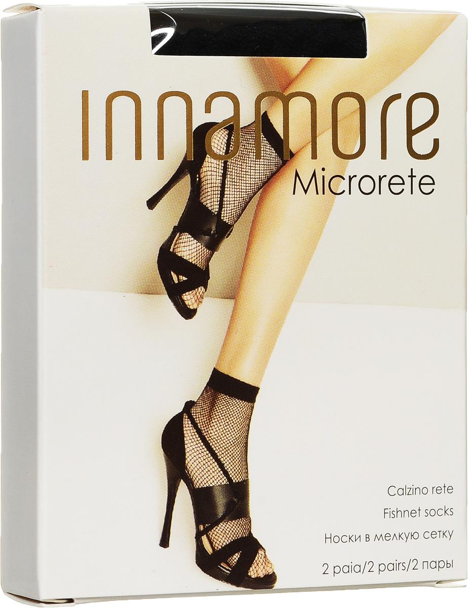 Носки женские Innamore Microrete 20, цвет: Nero (черный), 2 пары. 7819. Размер универсальный7819Удобные женские носки в мелкую сетку Innamore Microrete 20, изготовленные из высококачественного эластичного полиамида, идеально подойдут для повседневной носки. Входящий в состав материала полиамид обеспечивает износостойкость, а эластан позволяет носочкам легко тянуться, что делает их комфортными в носке.Эластичная резинка плотно облегает ногу, не сдавливая ее, обеспечивая комфорт и удобство и не препятствуя кровообращению. Практичные и комфортные носки великолепно подойдут к любой открытой обуви. В комплект входят 2 пары носков.