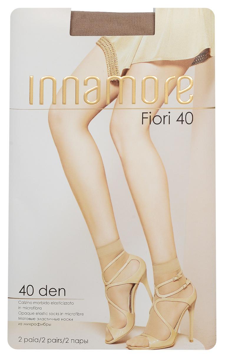 Носки женские Innamore Fiori 40, цвет: Miele (телесный), 2 пары. 5768. Размер универсальный5768Удобные женские носки Innamore Fiori 40, изготовленные из высококачественного эластичного полиамида, идеально подойдут для повседневной носки. Входящий в состав материала полиамид обеспечивает износостойкость, а эластан позволяет носочкам легко тянуться, что делает их комфортными в носке.Эластичная резинка плотно облегает ногу, не сдавливая ее, обеспечивая комфорт и удобство и не препятствуя кровообращению. Практичные и комфортные носки великолепно подойдут к любой открытой обуви. В комплект входят 2 пары носков.