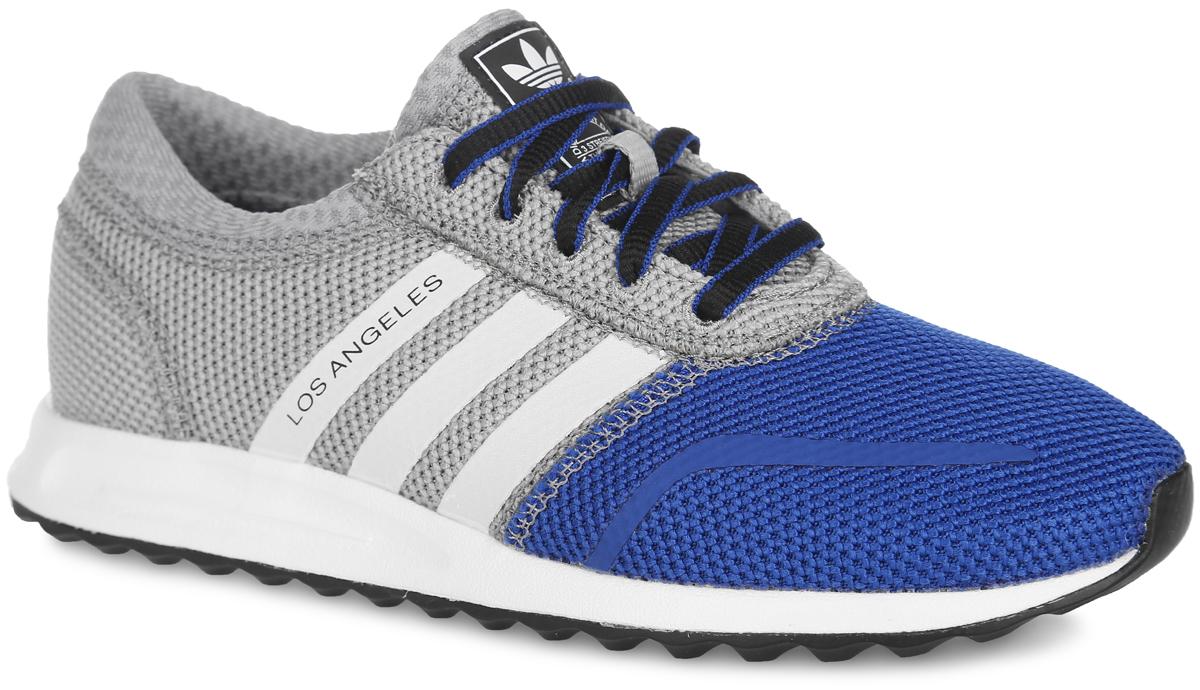 Кроссовки детские adidas Originals Los Angeles, цвет: синий, серый. S74877. Размер 2 (21,5)S74877Стильные кроссовки Los Angeles от adidas Originals - это детская версия легендарных кроссовок Los Angeles, выполненная в ретро-стиле. Верх, изготовленный из вязаного текстиля, дополнен бесшовными накладками из ПВХ. Модель оформлена по бокам матовыми полосками, одна из которых дополнена надписью Los Angeles, на язычке - фирменной нашивкой. Классическая шнуровка надежно фиксирует модель на ноге. Подкладка из текстиля не натирает. Амортизирующая дышащая стелька OrthoLite из материала ЭВА с текстильной поверхностью, благодаря специальному составу, препятствует распространению бактерий, вызывающих запах. Литая промежуточная подошва из легкого материала ЭВА обеспечивает оптимальную амортизацию. Резиновая подошва с протектором гарантирует идеальное сцепление с любыми поверхностями. В таких кроссовках ногам вашего ребенка будет комфортно и уютно.