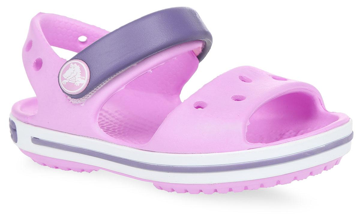 Сандалии детские Crocs Crocband, цвет: розовый. 12856-6ML. Размер C10 (27)12856-6MLПрелестные сандалии Crocband от Crocs очаруют вашего ребенка с первого взгляда! Модель выполнена из полимера Croslite и дополнена по периметру подошвы контрастной полоской с названием бренда. Благодаря материалу Croslite обувь невероятно легкая, мягкая и удобная. Материал Croslite - бактериостатичен, препятствует появлению неприятных запахов и легок в уходе: быстро сохнет и не оставляет следов на любых поверхностях. Верх модели оформлен отверстиями, которые можно использовать для украшения джибитсами. Под воздействием температуры тела обувь принимает форму стопы. Ремешок с застежкой-липучкой, оформленный фирменным логотипом, обеспечивает надежную фиксацию модели на ноге. Рельефная поверхность верхней части подошвы комфортна при движении. Рифленое основание подошвы гарантирует идеальное сцепление с любой поверхностью. Такие сандалии принесут комфорт и радость вашему ребенку.