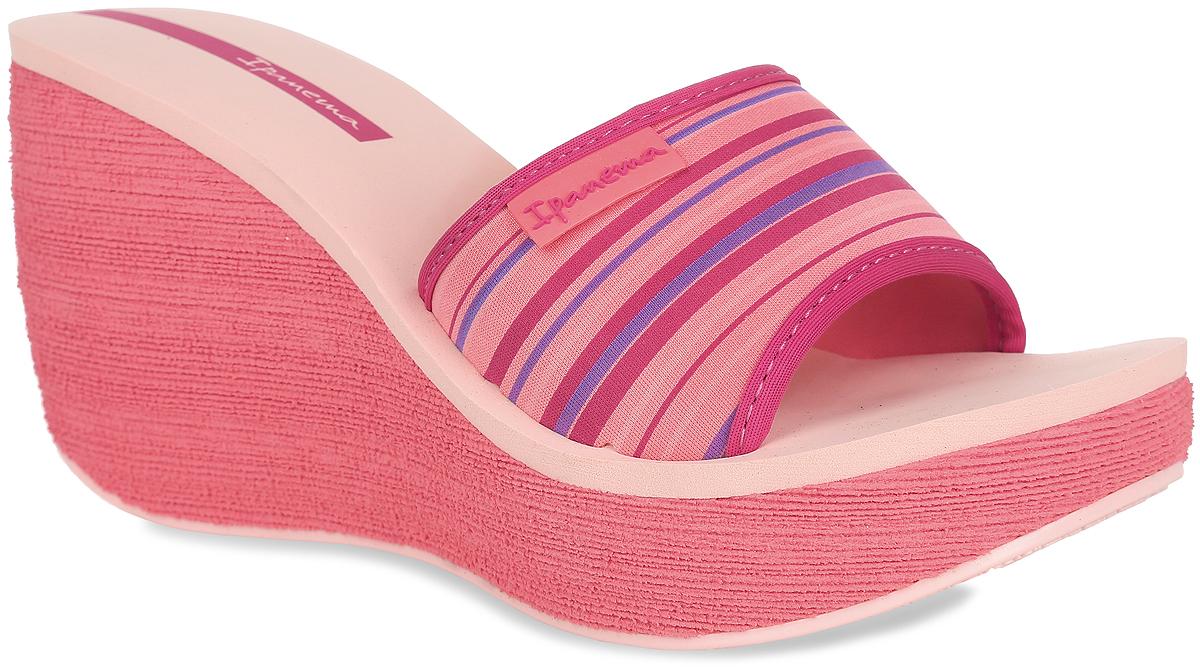 Шлепанцы на платформе женские Ipanema Neoprint Slide Fem, цвет: бледно-розовый, коралловый, фуксия. 81844-21721. Размер BRA 36 (37)81844-21721Оригинальные женские шлепанцы на платформе Neoprint Slide Fem от Ipanema займут достойное место среди вашей летней обуви. Верх модели, изготовленный из текстиля, оформлен названием бренда и принтом в полоску. Верхняя часть подошвы, выполненная из EVA-материала, невероятно комфортна при движении. Высокая танкетка компенсирована небольшой платформой. Рельефное основание подошвы обеспечивает уверенное сцепление с любой поверхностью. Удобные шлепанцы - необходимая вещь в гардеробе каждой женщины.