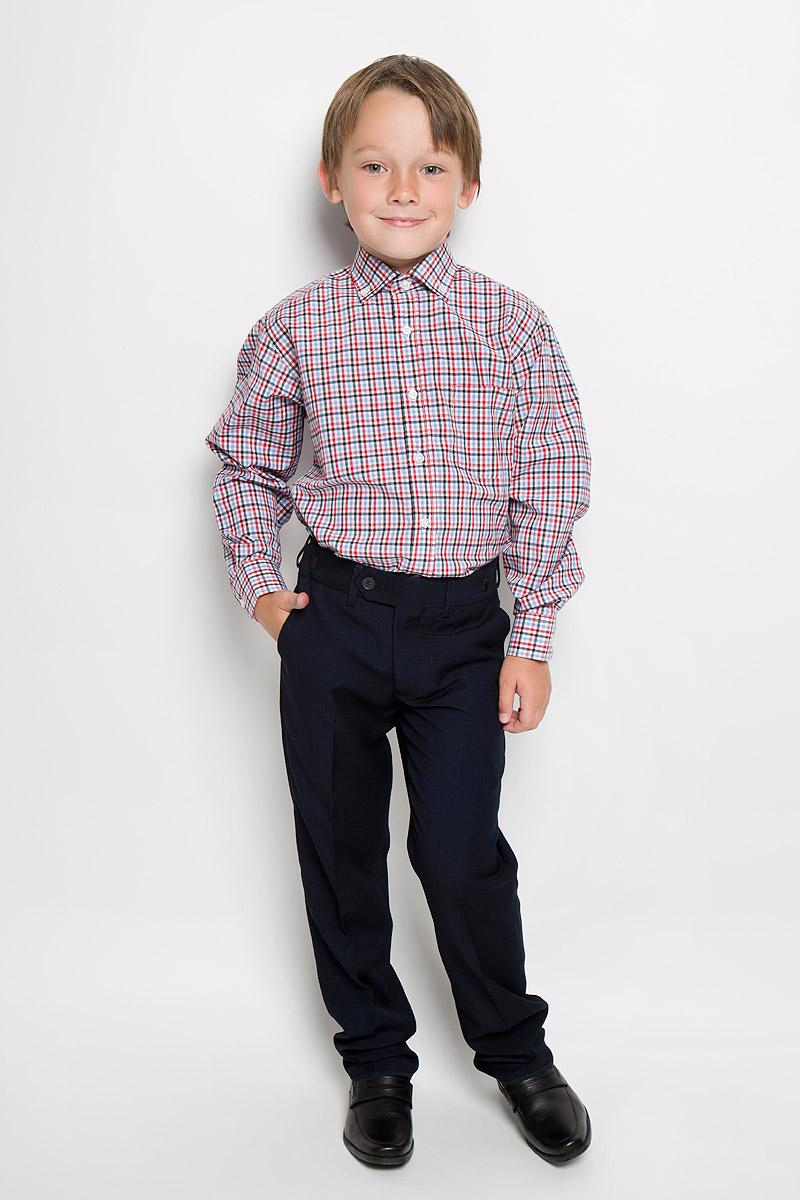 Рубашка для мальчика Imperator, цвет: красный, черный, голубой, белый. TR.102/ST/038/25. Размер 32/140-146, 9-11 летTR.102/ST/038/25Стильная рубашка для мальчика Imperator идеально подойдет вашему юному мужчине. Изготовленная из хлопка с добавлением полиэстера, она мягкая и приятная на ощупь, не сковывает движения и позволяет коже дышать, не раздражает даже самую нежную и чувствительную кожу ребенка, обеспечивая ему наибольший комфорт. Модель классического кроя с длинными рукавами и отложным воротничком застегивается по всей длине на пуговицы. Края воротника пристегиваются к рубашке с помощью пуговиц. На груди располагается накладной карман. Края рукавов дополнены широкими манжетами на пуговицах. Низ изделия немного закруглен к боковым швам. Оформлено изделие принтом в клетку. Такая рубашка будет прекрасно смотреться с брюками и джинсами. Она станет неотъемлемой частью детского гардероба.