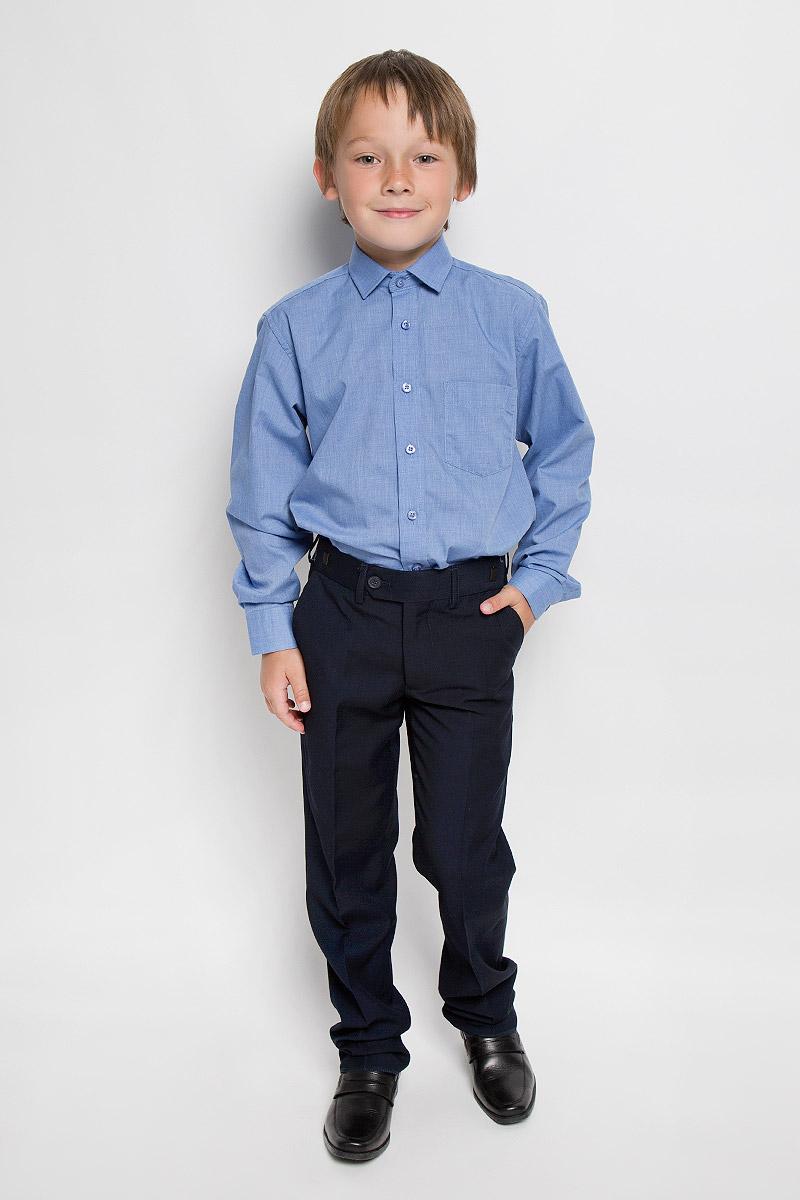 Рубашка для мальчика Imperator, цвет: синий. LT Blue. Размер 33/146-152, 9-11 летLT BlueСтильная рубашка для мальчика Imperator идеально подойдет вашему юному мужчине. Изготовленная из хлопка с добавлением полиэстера, она мягкая и приятная на ощупь, не сковывает движения и позволяет коже дышать, не раздражает даже самую нежную и чувствительную кожу ребенка, обеспечивая ему наибольший комфорт. Модель классического кроя с длинными рукавами и отложным воротничком застегивается по всей длине на пуговицы. На груди располагается накладной карман. Края рукавов дополнены широкими манжетами на пуговицах. Низ изделия немного закруглен к боковым швам. Такая рубашка будет прекрасно смотреться с брюками и джинсами. Она станет неотъемлемой частью детского гардероба.