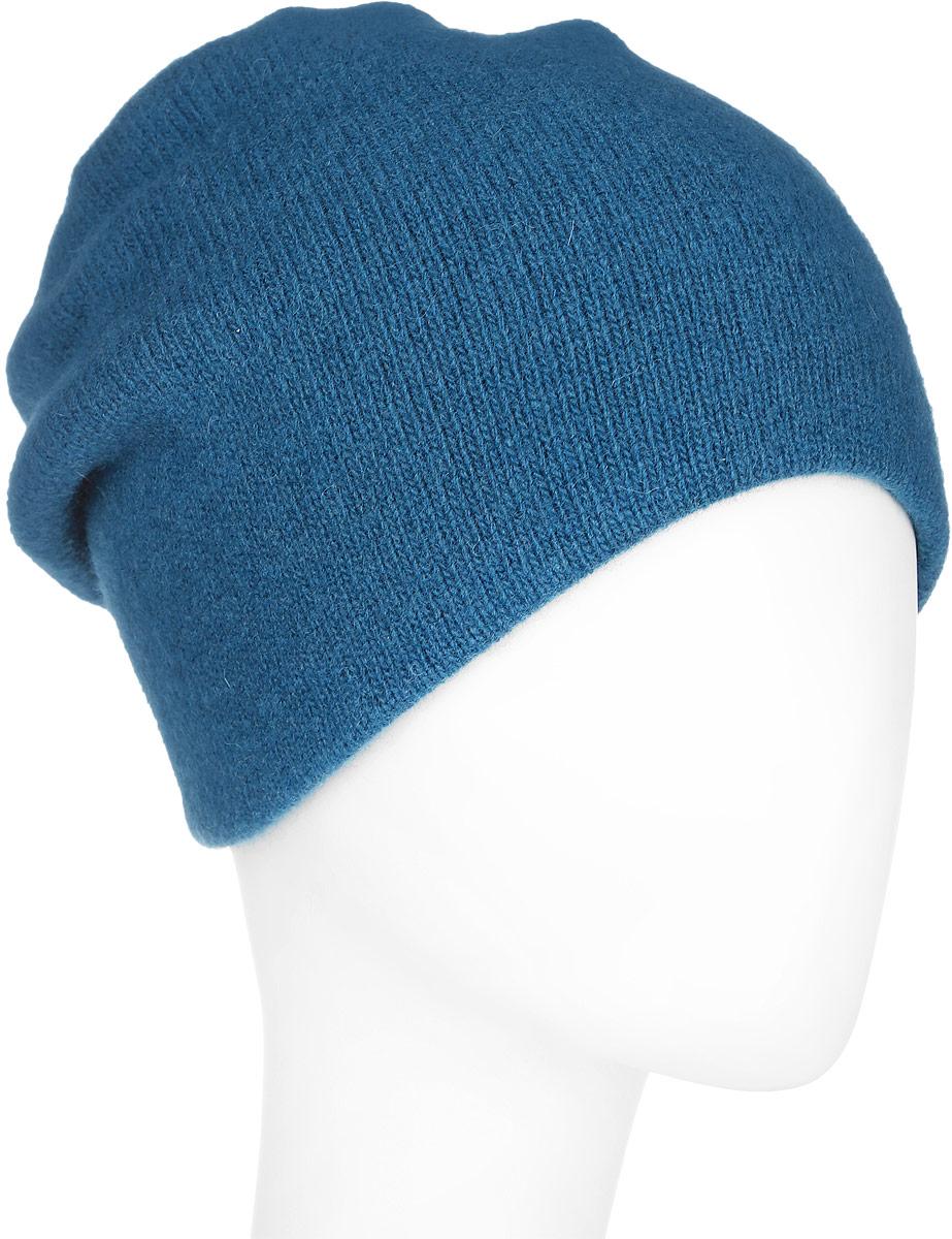 Шапка женская Finn Flare, цвет: синий. A16-11161_140. Размер 56A16-11161_140Стильная женская шапка Finn Flare дополнит ваш наряд и не позволит вам замерзнуть в холодное время года. Шапка выполнена из высококачественной пряжи, что позволяет ей великолепно сохранять тепло и обеспечивает высокую эластичность и удобство посадки. Изделие дополнено тёплой подкладкой.Модель оформлена металлической нашивкой с названием бренда. Такая шапка станет модным и стильным дополнением вашего гардероба. Она согреет вас и позволит подчеркнуть свою индивидуальность!