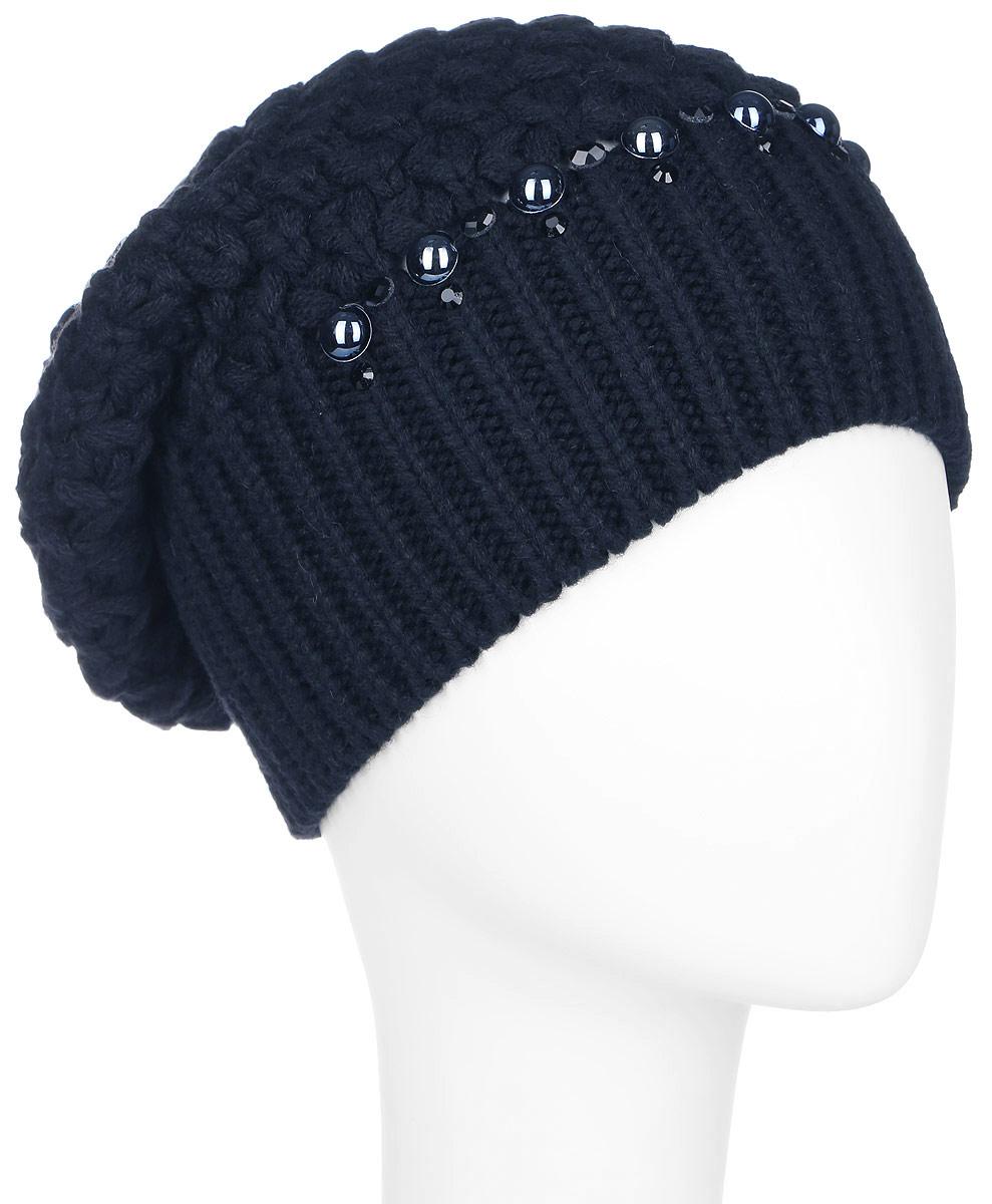 Шапка женская Finn Flare, цвет: темно-синий. A16-11150_101. Размер 56A16-11150_101Стильная женская шапка Finn Flare дополнит ваш наряд и не позволит вам замерзнуть в холодное время года. Шапка выполнена из высококачественной пряжи, что позволяет ей великолепно сохранять тепло и обеспечивает высокую эластичность и удобство посадки.Модель оформлена кристаллами, пластиковыми полубусинами и металлической нашивкой с названием бренда. Такая шапка станет модным и стильным дополнением вашего гардероба. Она согреет вас и позволит подчеркнуть свою индивидуальность!