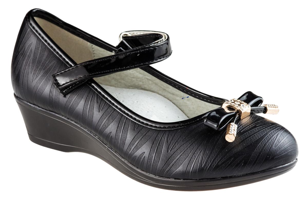 Туфли для девочки Аdagio, цвет: черный. MX83080-32. Размер 31MX83080-32Модные туфли для девочки от Аdagio выполнены из искусственной кожи с рельефной поверхностью. Мыс изделия дополнен декоративным бантиком с металлическими элементами, украшенными стразами. Внутренняя поверхность из натуральной кожи не натирает. Стелька из ЭВА материала с поверхностью из натуральной кожи дополнена супинатором. Ремешок с застежкой-липучкой надежно зафиксирует модель на ноге. Подошва дополнена рифлением.