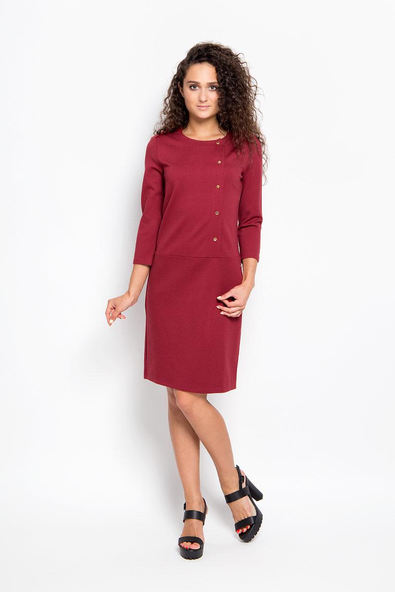 Платье Finn Flare, цвет: гранатовый. A16-12038_303. Размер XS (42)A16-12038_303Элегантное платье Finn Flare выполнено из эластичной вискозы с добавлением нейлона. Такое платье обеспечит вам комфорт и удобство при носке и непременно вызовет восхищение у окружающих.Модель-миди с рукавами 3/4 и круглым вырезом горловины выгодно подчеркнет все достоинства вашей фигуры. Изделие застегивается на крупные кнопки спереди. Модель с пришивной юбкой украшена небольшим металлическим лейблом. Изысканное платье-миди создаст обворожительный и неповторимый образ.Это модное и комфортное платье станет превосходным дополнением к вашему гардеробу, оно подарит вам удобство и поможет подчеркнуть свой вкус и неповторимый стиль.