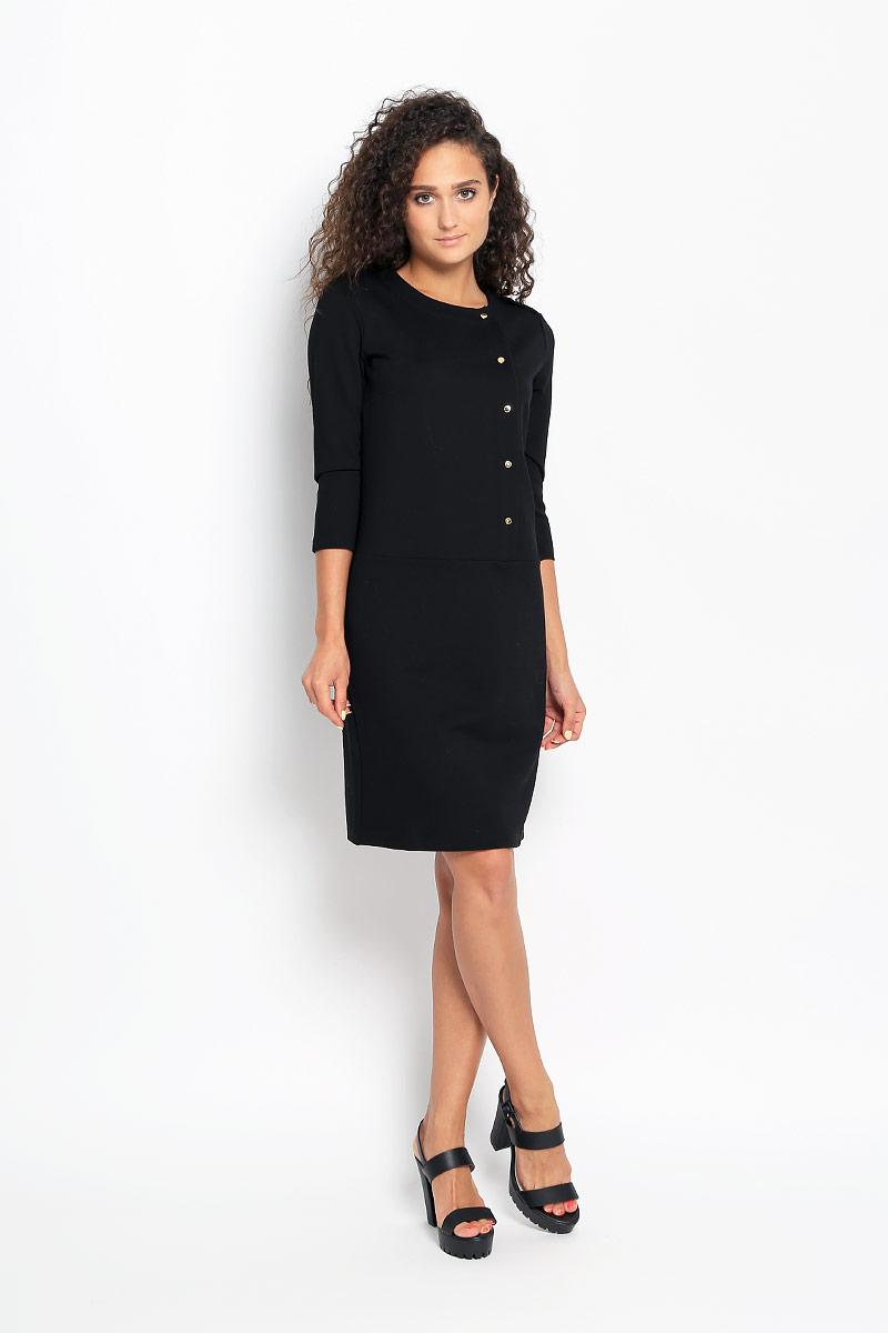 Платье Finn Flare, цвет: черный. A16-12038_200. Размер M (46)A16-12038_200Элегантное платье Finn Flare выполнено из эластичной вискозы с добавлением нейлона. Такое платье обеспечит вам комфорт и удобство при носке и непременно вызовет восхищение у окружающих.Модель-миди с рукавами 3/4 и круглым вырезом горловины выгодно подчеркнет все достоинства вашей фигуры. Изделие застегивается на крупные кнопки спереди. Модель с пришивной юбкой украшена небольшим металлическим лейблом. Изысканное платье-миди создаст обворожительный и неповторимый образ.Это модное и комфортное платье станет превосходным дополнением к вашему гардеробу, оно подарит вам удобство и поможет подчеркнуть свой вкус и неповторимый стиль.