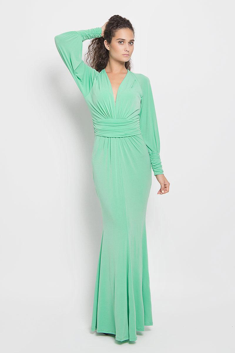 Платье Ruxara, цвет: светло-зеленый. 106100_39. Размер 42106100_39Стильное платье-макси Ruxara, выполненное из высококачественного комбинированного материала, поможет создать отличный современный образ.Модель приталенного силуэта с глубоким V-образным вырезом горловины и длинными рукавами-реглан. Низ рукавов дополнен широкими манжетами, которые собраны на резинку. Изделие по талии оформлено широким поясом со сборкой.Такое платье поможет создать яркий и привлекательный образ, в нем вам будет удобно и комфортно.