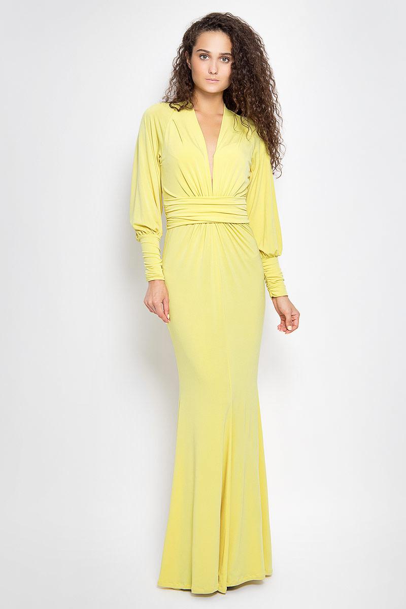 Платье Ruxara, цвет: желтый. 106100_81. Размер 44106100_81Стильное платье-макси Ruxara, выполненное из высококачественного комбинированного материала, поможет создать отличный современный образ.Модель приталенного силуэта с глубоким V-образным вырезом горловины и длинными рукавами-реглан. Низ рукавов дополнен широкими манжетами, которые собраны на резинку. Изделие по талии оформлено широким поясом со сборкой.Такое платье поможет создать яркий и привлекательный образ, в нем вам будет удобно и комфортно.