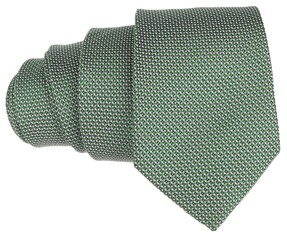 Галстук BTC, цвет: зеленый. 12.014121. Размер универсальный12.014121Стильный галстук BTC станет отличным завершающим штрихом вашего образа. Этот модный аксессуар порадует вас высоким качеством исполнения и современным дизайном. Изделие полностью выполнено из качественного шелка. Галстук оформлен оригинальным принтом.Такой оригинальный галстук подойдет как к повседневному, так и к официальному наряду, он позволит вам подчеркнуть свою индивидуальность и создать свой неповторимый стиль.
