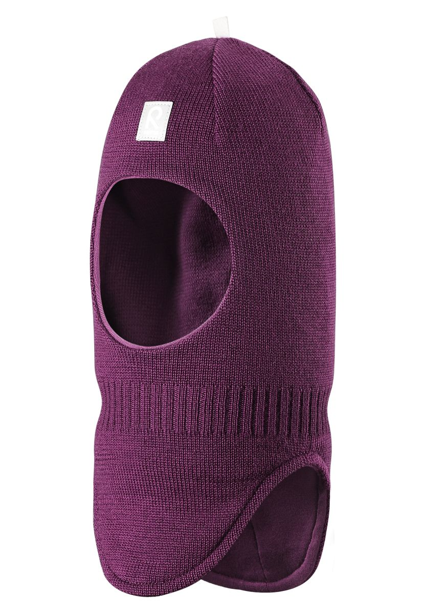 Балаклава детская Reima Starrie, цвет: фиолетовый. 518315-4900. Размер 46518315-4900Уютная детская шапка-шлем Reima Starrie идеально подойдет для прогулок в холодное время года. По своей конструкции шлем облегает голову ребенка, надежно защищая ушки, лоб и щечки от продуваний. Вязаная шапочка-шлем, выполненная из 100% шерсти на мягкой подкладке из эластичного хлопка, прекрасно сохраняет тепло и обладает отличной гигроскопичностью (не впитывает влагу, но проводит ее), она мягкая и идеально прилегает к голове. Спереди предусмотрена небольшая светоотражающая нашивка с логотипом бренда, которая не оставит вашего ребенка незамеченным в темное время суток. Оригинальный дизайн и высокое качество делают эту шапку модным и стильным предметом детского гардероба. В ней ваш ребенок будет чувствовать себя уютно и комфортно и всегда будет в центре внимания! Уважаемые клиенты!Размер, доступный для заказа, является обхватом головы.