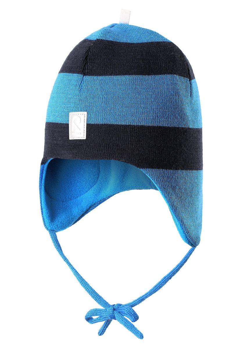 Шапка детская Reima Auva, цвет: голубой. 518316-6560A. Размер 48518316-6560AШерстяная шапка для малышей согреет в морозную погоду: мягкая подкладка из флиса для тепла и комфорта. Шерстяная шапка с подкладкой из флиса особенно подходит для маленьких приключений на свежем воздухе, потому что флис быстро высыхает и хорошо выводит влагу. Благодаря эластичной вязке шапка плотно прилегает, а ветронепроницаемые вставки в области ушей защищают маленькие ушки от холодного ветра. Завязки надёжно фиксируют шапку на голове и не натирают.