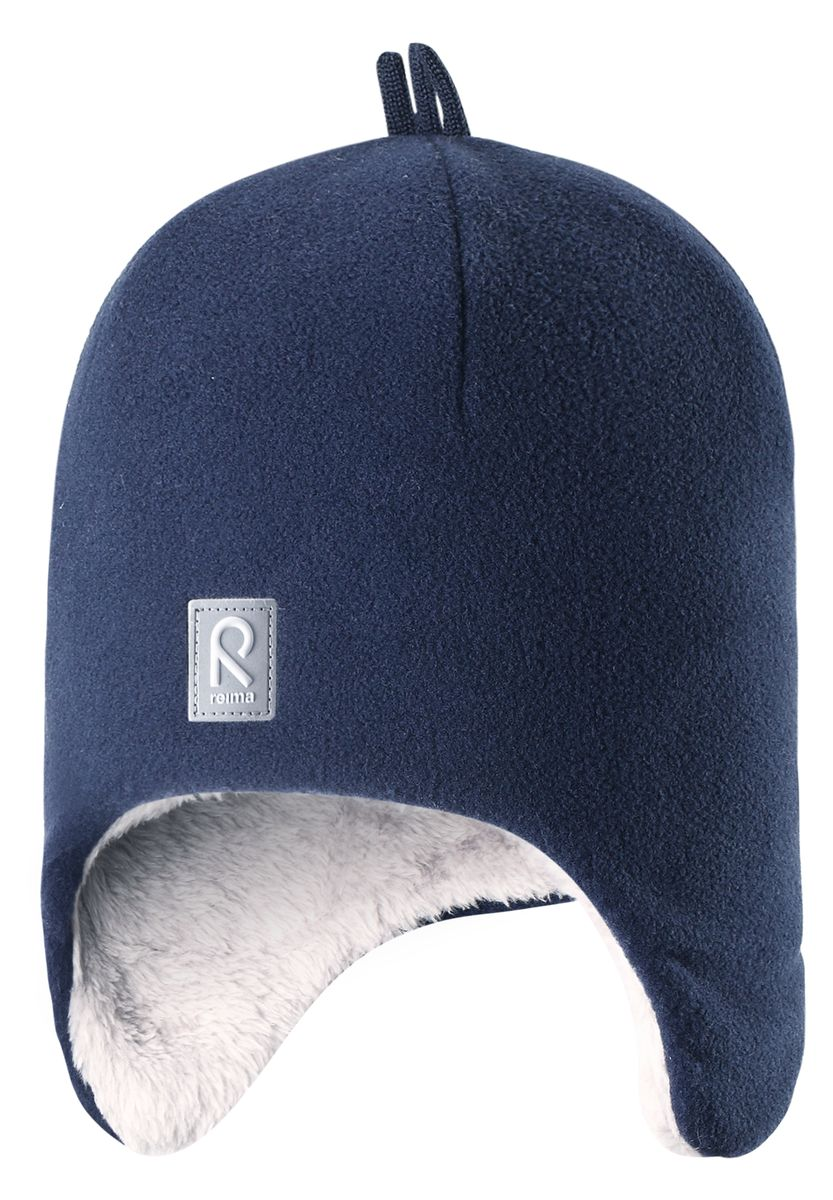 Шапка детская Reima Toppen, цвет: синий. 528452-6980A. Размер 48528452-6980AКрасивая и модная шапка для малышей и детей постарше украшена забавными деталями в зимнем стиле! Она сделана из теплого и мягкого флиса и имеет уютную вязаную подкладку. Ветронепроницаемые вставки в области ушей защищают маленькие ушки от резкого ветра и холодной погоды во время игры в снежки. Стильные и классические цвета оживят любую одежду и легко с ней сочетаются.
