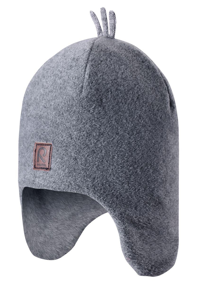 Шапка детская Reima Toppen, цвет: серый. 528452-9400A. Размер 48528452-9400AКрасивая и модная шапка для малышей и детей постарше украшена забавными деталями в зимнем стиле! Она сделана из теплого и мягкого флиса и имеет уютную вязаную подкладку. Ветронепроницаемые вставки в области ушей защищают маленькие ушки от резкого ветра и холодной погоды во время игры в снежки. Стильные и классические цвета оживят любую одежду и легко с ней сочетаются.