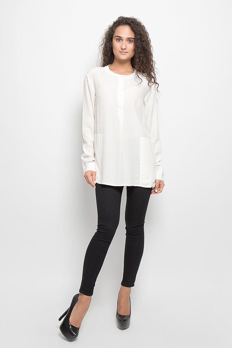 Блузка женская Baon, цвет: белый. B176513. Размер XS (42)B176513_MilkСтильная женская блуза Baon, выполненная из 100% вискозы, подчеркнет ваш уникальный стиль и поможет создать оригинальный женственный образ.Блузка с длинными рукавами и круглым вырезом горловины застегивается на пуговицы на груди. Манжеты рукавов также застегиваются на пуговицы. Блузка двумя втачными карманами. Такая блузка идеально подойдет для жарких летних дней. Такая блузка будет дарить вам комфорт в течение всего дня и послужит замечательным дополнением к вашему гардеробу.