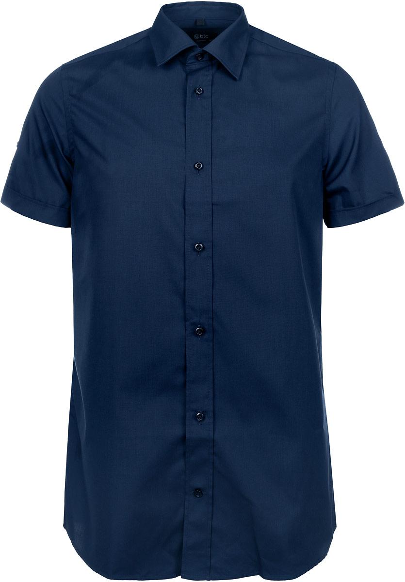 Рубашка мужская BTC, цвет: темно-синий. 12.015102. Размер 56-17612.015102Мужская рубашка BTC, выполненная из высококачественного материала, станет стильным дополнением к вашему гардеробу. Изделие тактильно приятное, не сковывает движений и хорошо пропускает воздух, обеспечивая комфорт при носке.Модель с отложным воротником и короткими рукавами застегивается спереди на пуговицы. Рубашка имеет слегка приталенный силуэт. Рукава дополнены декоративными отворотами и хлястиками на пуговицах. Такая рубашка подчеркнет ваш вкус и поможет создать отличный современный образ!