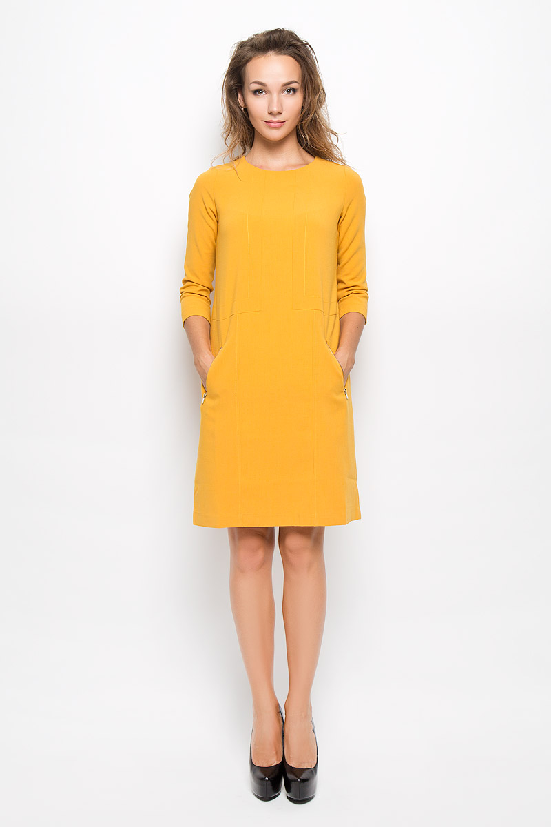 Платье Baon, цвет: охра. B434. Размер S (44)B434_Dark OchreЭлегантное платье Baon выполнено из высококачественного эластичного полиэстера с добавлением вискозы. Такое платье обеспечит вам комфорт и удобство при носке и непременно вызовет восхищение у окружающих. Платье превосходно тянется, обладает высокой износостойкостью и отлично сидит по фигуре. Модель средней длины с рукавами 7/8 и круглым вырезом горловины выгодно подчеркнет все достоинства вашей фигуры. Платье застегивается на застежку-молнию на спинке. Спереди расположены два втачных кармана на застежках-молниях. Изысканное платье-миди создаст обворожительный и неповторимый образ.Это модное и комфортное платье станет превосходным дополнением к вашему гардеробу, оно подарит вам удобство и поможет подчеркнуть ваш вкус и неповторимый стиль.