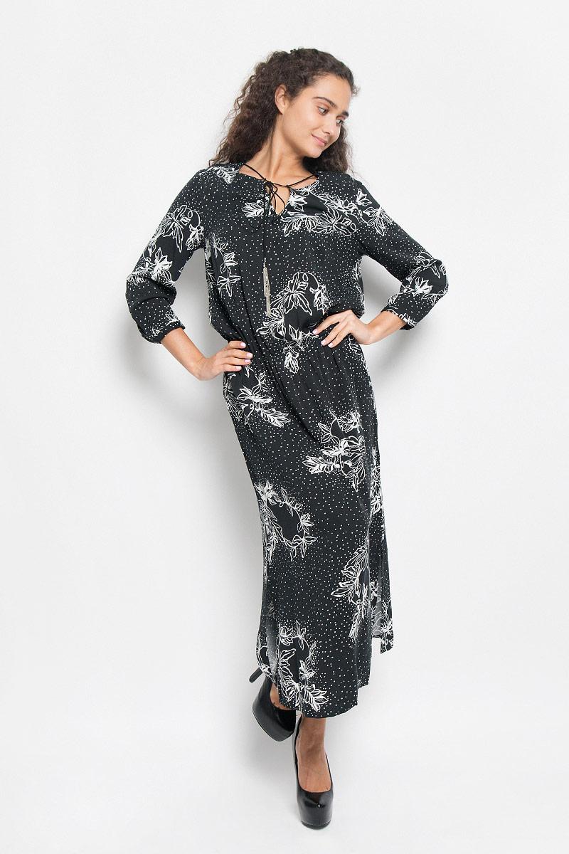 Платье Baon, цвет: черный, белый. B435. Размер S (44)B435_BLACK PRINTEDЭлегантное платье Baon выполнено из 100% вискозы. Такое платье обеспечит вам комфорт и удобство при носке и непременно вызовет восхищение у окружающих.Платье-макси с круглым вырезом горловины и рукавами длинной 3/4. Низ рукавов дополнен узкими манжетами на пуговицах. Горловина оформлена декоративным разрезом и оригинальным шнурком. По талии изделие собрано на резинку, а в боковых швах обработаны разрезы. Изысканное платье-макси, оформленное цветочным принтом, создаст обворожительный и неповторимый образ.Это модное и комфортное платье станет превосходным дополнением к вашему гардеробу, оно подарит вам удобство и поможет подчеркнуть ваш вкус и неповторимый стиль.